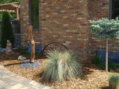 ironwood bleached and sanded garden art piece with col. blue spruce on standard and stacked stone arrangement located in Flint Township, MI
