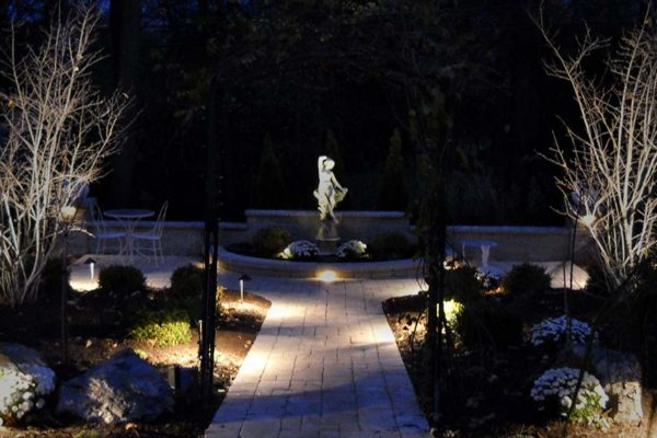 Safety security beauty led landscape lighting installation moonlight garden lit by kitchler landscape lighting system with pathlights and integral lights mounted in retaining aloadofball Choice Image
