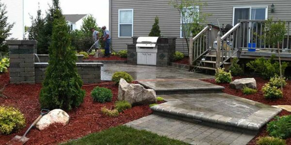 Built-in natural gas grill BBQ. Unilock olde greenwich, copthorne and unigranite pavers located in Davison, MI