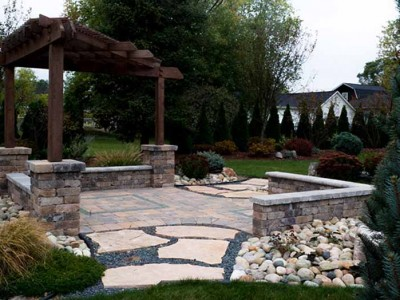 3 post cedar pergola with unilock patio and pillars, seat walls and flagstone walk located in Mt Morris, MI