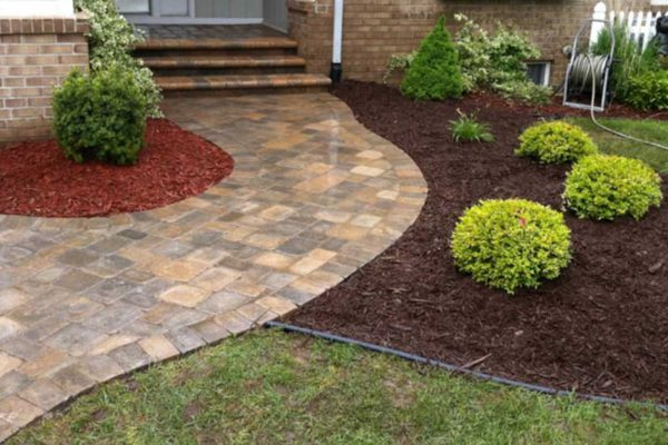 UniIock brussels curved walk with steps to porch in desert sand located in Flushing, MI