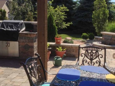 Natural gas grill BBQ, cedar pergola , water fall, and patio with unilock. Outdoor living space located in Flint Township , MI