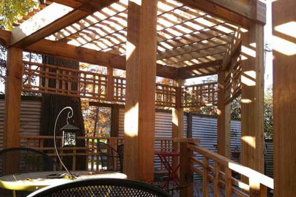 Custom cedar pergola with multiple levels and privacy screening located in Flint, MI