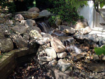 vanishing water fall with boulders located in Grand Blanc, MI