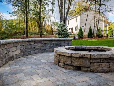 Rosetta round fire pit, and unilock paver patio and walk of a home located in Howell, MI