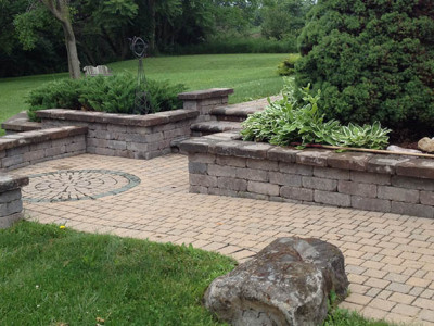 Side walk and patio with steps and retaining wall located in Davison, MI