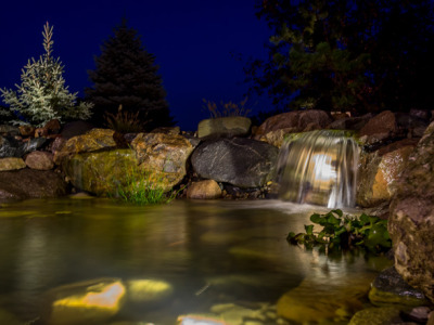 Koi Pond Lit by LED landscape lights in Genesee County, MI