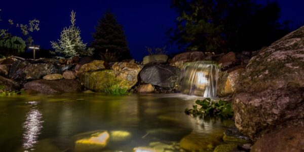 Koi Pond Lit by LED landscape lights in Genesee County, MI