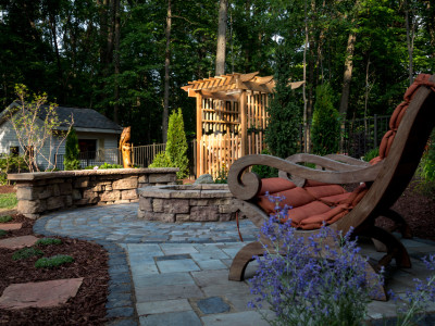 Outdoor Living area centered around a Rosetta firepit and custom cedar arbor located in Metamora, MI.