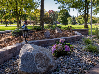 Brussels Block retaining walls with boulders, plants and decorative stone in Davison, MI